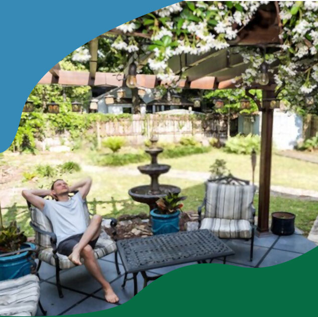 man relaxing in yard